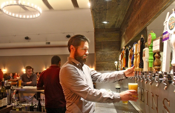 Ryan Hummel Bar Manager For Steins Beer Garden Restaurant In Mountain View Pours A Glass Of
